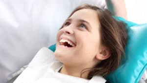 Child in dental chair during examination and treatment