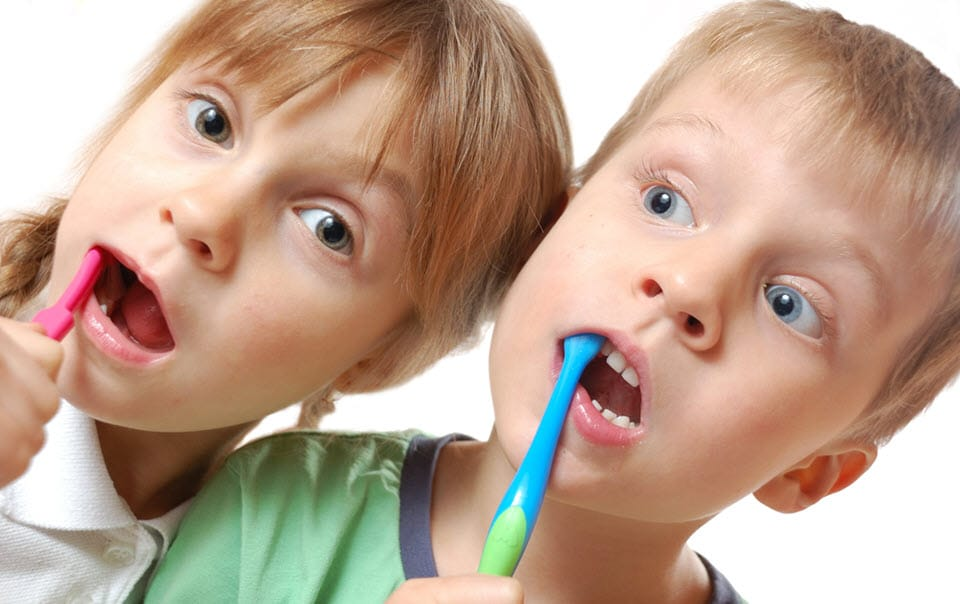 Children brushing their teeth